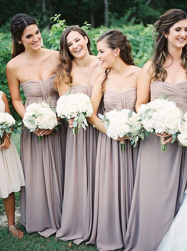 Bridesmaids dresses by Andrew Adela in Latte.  Photographer: Tracy Enoch Photography / Videographer: Landon Whinery / Planner, Florist, Rentals, Lighting, and Special Details: Elixir Events / Venue and Caterer: Mitas Hill Vineyard / Cake Baker: Flour Child Cakery / Music: Peter Nicholas / Paper Products: The Magic Pen and Party / Bride's Gown: Lillian West / Bridal Salon and Accessories: The Blushing Bride Boutique / Hair Stylist: Reah Meier of Be Youtiful Hair Designs / Makeup Artist…