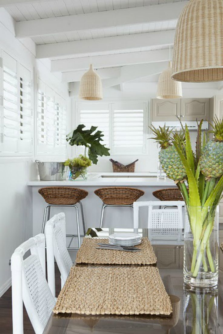 Coastal kitchen with light rattan shade chandeliers