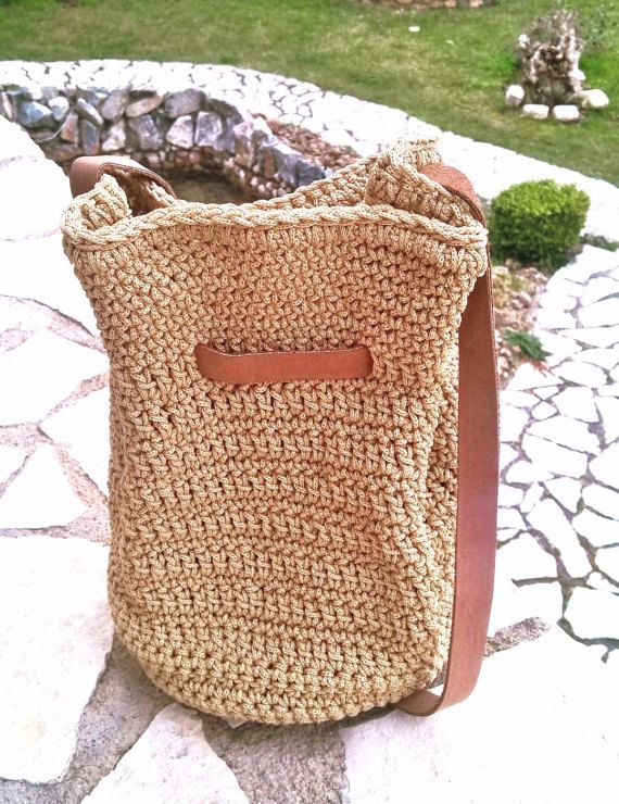 Welcome to my Etsy shop!!  Totally handmade crochet handbag!!   Hight quality cord in an amazing trendy color combined with excellent quality genuine leather handles in natural color  Beige of sand color, one of the most fashionable color for Spring/Summer 2017 season Covers your everyday needs because of the comfortable zise  African style Boho style Hippie style  The must have spring and summer pouch.  Fine fabric inside lining Magnetic clasp. Genuine leather handle 1meter lenght Genuine…