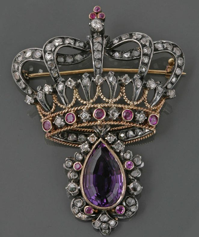An amethyst, ruby, diamond and silver-topped gold brooch in the form of a crown with detachable pendant measures approximately 52w x 71mm high including pendant. Victorian or Victorian style.