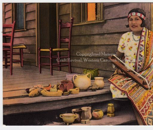 This is a postcard of a Cherokee woman, identified as Cora Wahnetah, posing with a bead loom and display of pottery. A member of the Eastern...