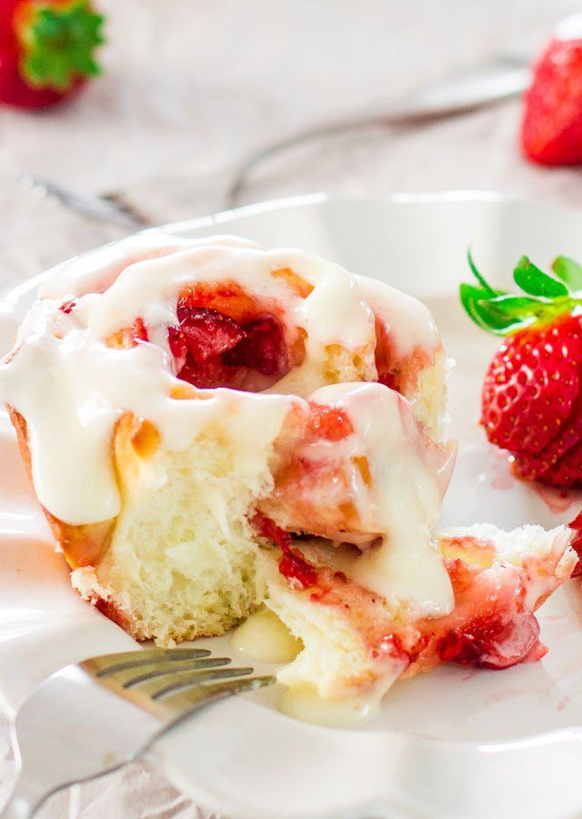 Strawberry Rolls with cream cheese icing - perfect for a weekend breakfast or brunch. Delicious sweet rolls with strawberry jam and fresh strawberries.