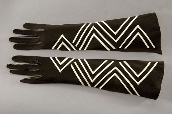 """Elbow-Length Gloves, Jay's Limited of London, France: 1930-1939, suede leather. """"The bold zigzag design on these gloves of applied white leather (it forms a diamond pattern when both gloves are put together) owes much to contemporary art movements, and particularly Art Deco...the movement owes its name to the major international exhibition of decorative arts held in Paris in 1925. This exhibition was called Exposition Internationale des Arts Décoratifs et Industriels Modernes."""""""
