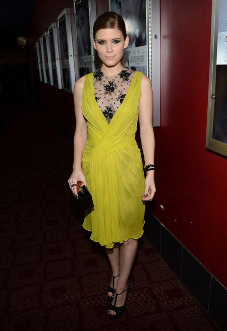 Kate Mara is wearing a Jason Wu dress and clutch paired with Brian A