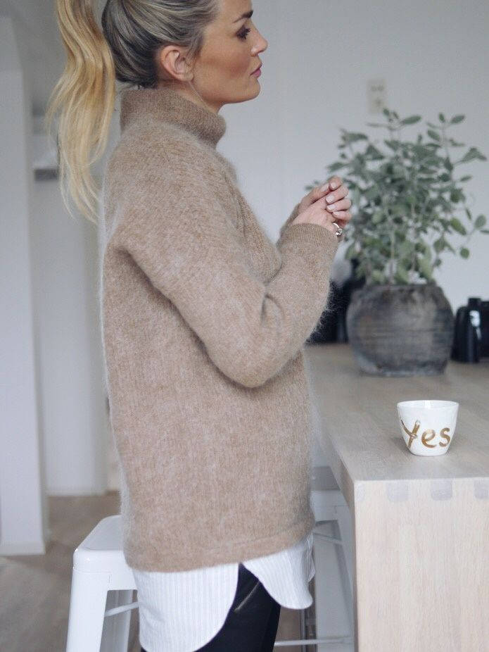 coffe mohair hi neck jumper layered over a long white shirt, great was of…