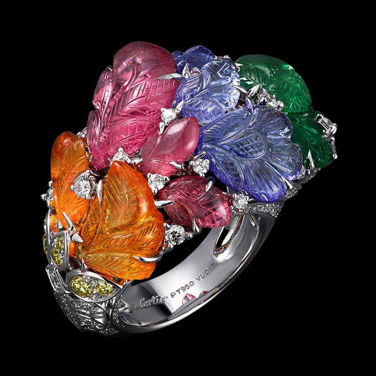 Anillo Platino, mandarina granates, turmalinas rosa, tanzanitas, granates tsavorita, diamantes amarillos, brillantes.