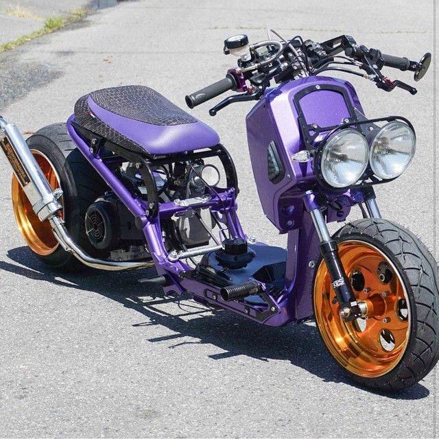 purple Honda Ruckus custom with orange rims