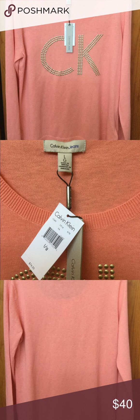 Calvin Klein Jeans Top Calvin Klein Top with long sleeves. Gold color design. Made of 55% cotton, 38% nylon and 7% rayon. The color is more like a light peach color but not on the option to select. Calvin Klein Jeans Sweaters Cardigans