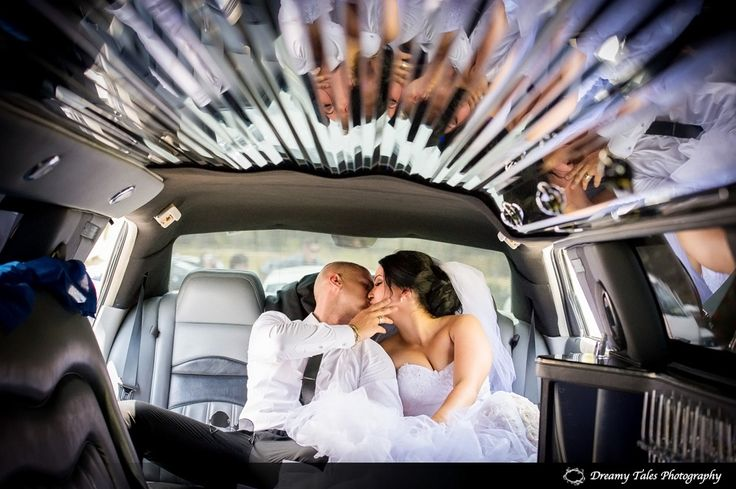 Wedding Photography- Bride and Groom in Wedding Car Limo. Brisbane