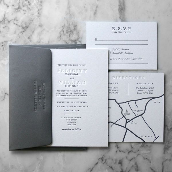 This gray letterpress invitation suite features more than just a pretty invite. All of the details also feature letterpress work, from the map enclosure to the back of each addressed envelope.