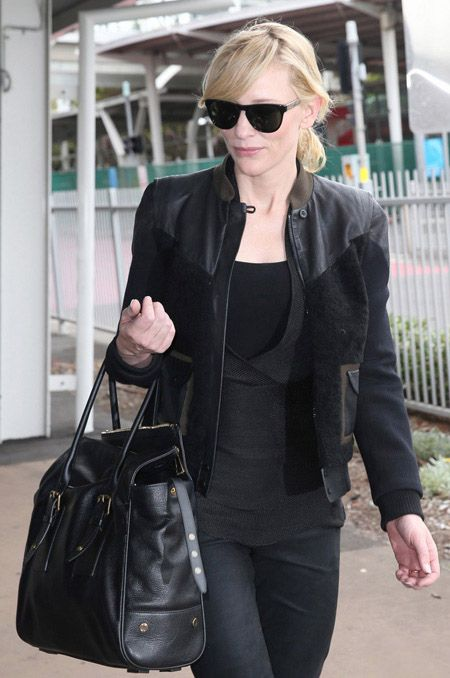 Miss Cate looks all kinds of badass here:   Cate Blanchett lands at Kingsford Smith International Airport in Sydney, Australia carrying a Belstaff bag