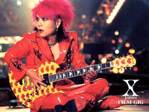 "hide was probably the most playful member of X Japan. :) His nickname was ""Pink Spider"" due to his wild, bright pink hair."