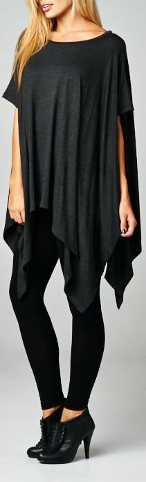 Casually chic poncho style tunic. Asymmetrical hem. Loose fit. Round neck. 95% Rayon, 5% Spandex. Made in USA.
