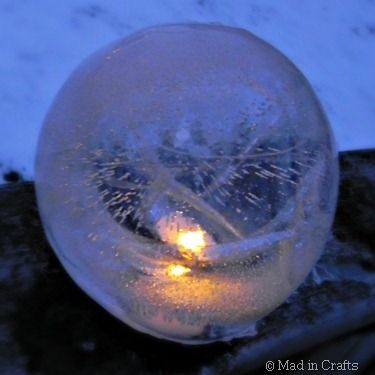 """""""Fire"""" & ice lantern - pretty awesome! Fill a balloon with water and let it freeze just enough for a thick shell of ice to form. Poor remaining water out, cut off balloon, and stick an led candle light underneath. This could be great for a party."""
