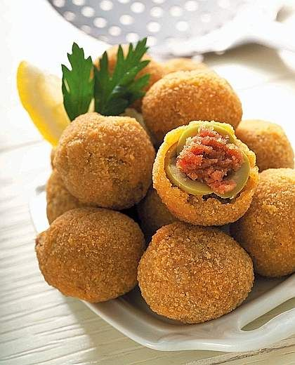 Olive Ascolane. Fried olives stuffed with meat. The maximum of the ...