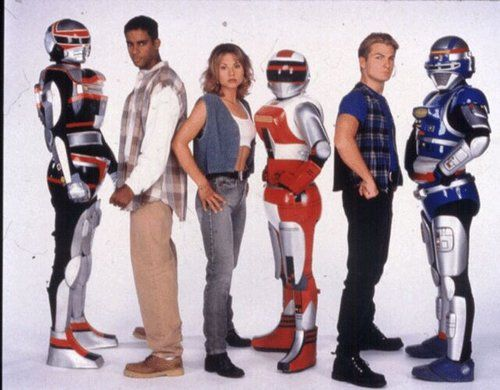 "VR Troopers"" focused on three diverse teenagers Ryan Steele, Kaitlin Star, and J.B. Reese, all of whom lived in the fictional Cross World City. Description from strangekidsclub.com. I searched for this on bing.com/images"
