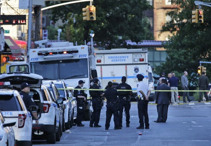 NYPD officer 'assassinated' while sitting in a marked police vehicle, officials say