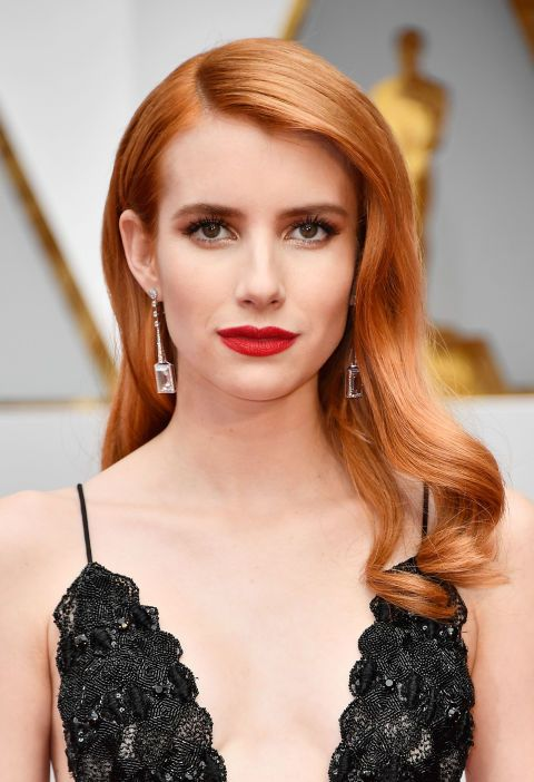 Roberts goes monochromatic with sleek strawberry blonde hair and matte red lips. To recreate Roberts' lip look, mix Matte Revolution in Red Carpet Red and Lip Cheat in Kiss 'N' Tell, both by Charlotte Tilbury.