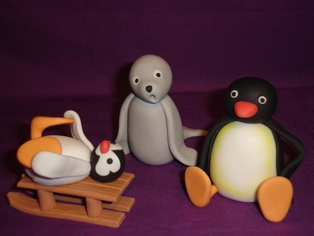 Pingu, Pinga and Robby - All ready for my grandson's cake on Friday. The sledge will have a pull string attached on the finished cake. These are made from sugarpaste (fondant) mixed with cmc powder (same as tylopur or tylose) for strength. :o)