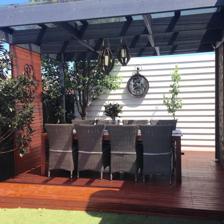 Surf mist weatherboard outdoor wall, vintage clock, merbau decking, outdoor dining table