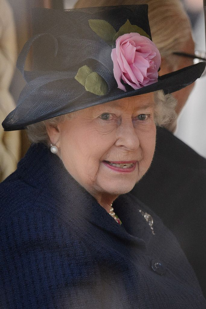 Queen Elizabeth II takes her seat in the State Carriage for the carriage procession as part of the ceremonial welcome ceremony for Singapore's President Tony Tan Keng Yam at the start of a state visit at Horse Guards Parade on October 21, 2014 in London, England.