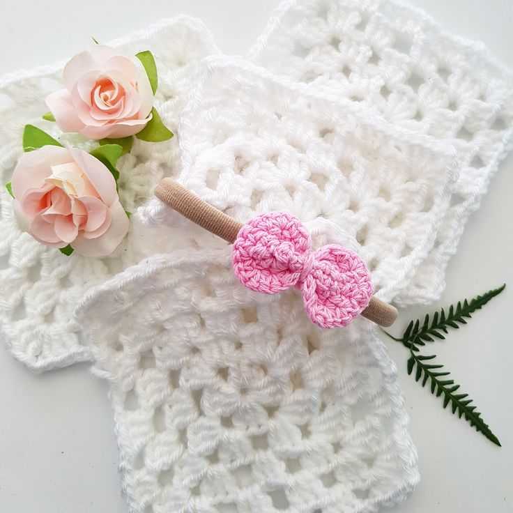 Pretty little Betsie is a crochet bow on a soft stretchy nude nylon hearband - one size fits all