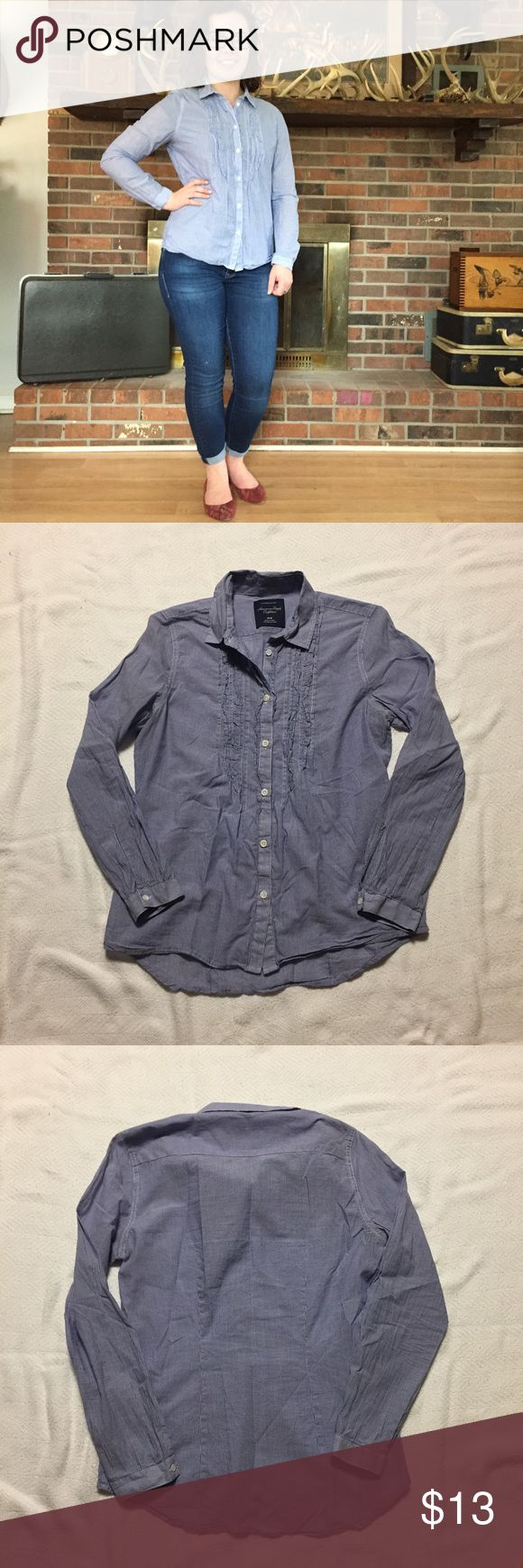 American Eagle favorite fit ruffle button down. American Eagle favorite fit ruffle button down. Blue and white vertical stripes. Wear with a cardigan and jeans for a casual look! If you would like modeled photos, just ask! Prices are firm. American Eagle Outfitters Tops Button Down Shirts