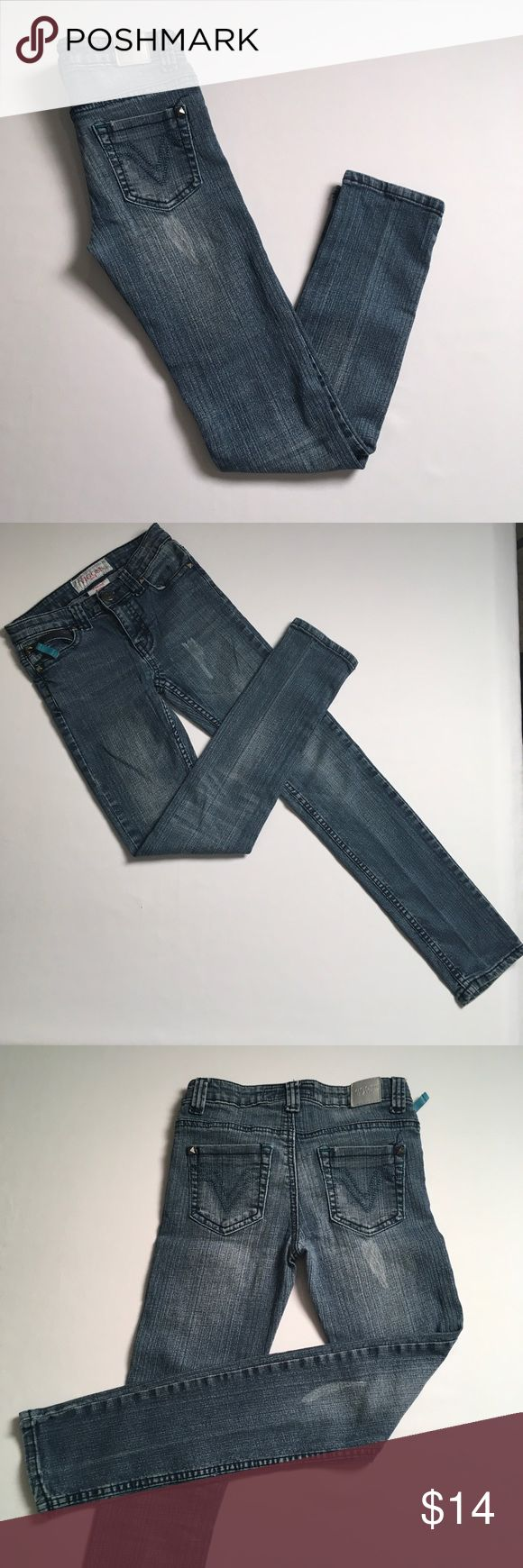 """Young ladies Vigoss Skinny Jeans Super cute distressed Vigoss Skinny Jeans  5 pockets Front 5th pocket has a cute zipper with turquoise tag flap Designs on back of pockets in a turquoise stitching Girls Size 12 Waist 24"""" Rise 7.5"""" Inseam 27"""" 55% ramie, 24% cotton , 20% polyester and 1% spandex  Non smoking environment  No stains, snags or damage  Thanks for Looking , Molly M 1289/ W 1 Vigoss Bottoms Jeans"""