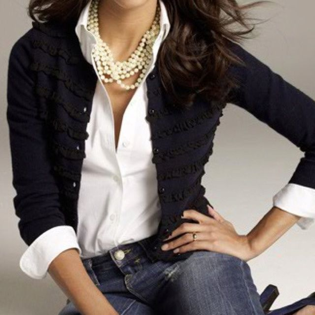 Black sweater with white blouse, pearls, and jeans |=
