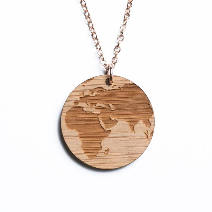 Africa and Asia map necklace, etched into eco-friendly FSC certified bamboo (using a laser burner), on a recycled rose gold plated sterling silver chain.