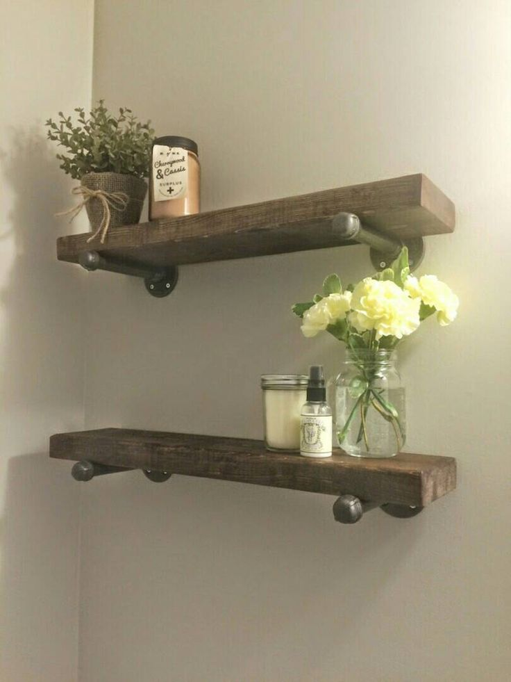 Rustic wood shelves with industrial pipe mount || pipe wood shelf || bathroom shelf || industrial chic shelves || custom wood furniture by PipeAndWoodDesigns on Etsy https://www.etsy.com/listing/238922751/rustic-wood-shelves-with-industrial-pipe