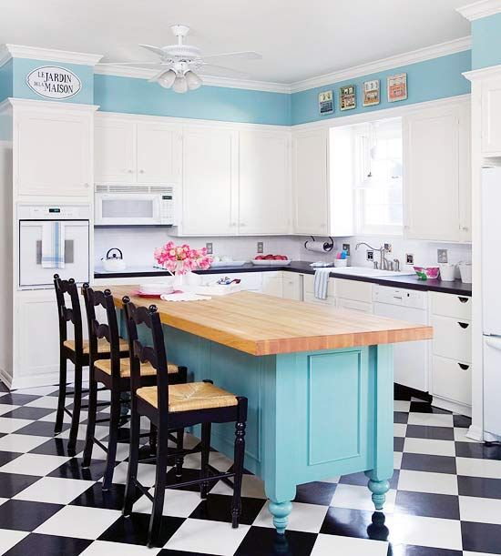 Taken by Teal  Ease color into a room with an attention-grabbing hue on a kitchen island. Teal blue does all the talking in this French-themed kitchen. Color on the upper wall and the island pops against a black-and-white backdrop, creating a striking color scheme.