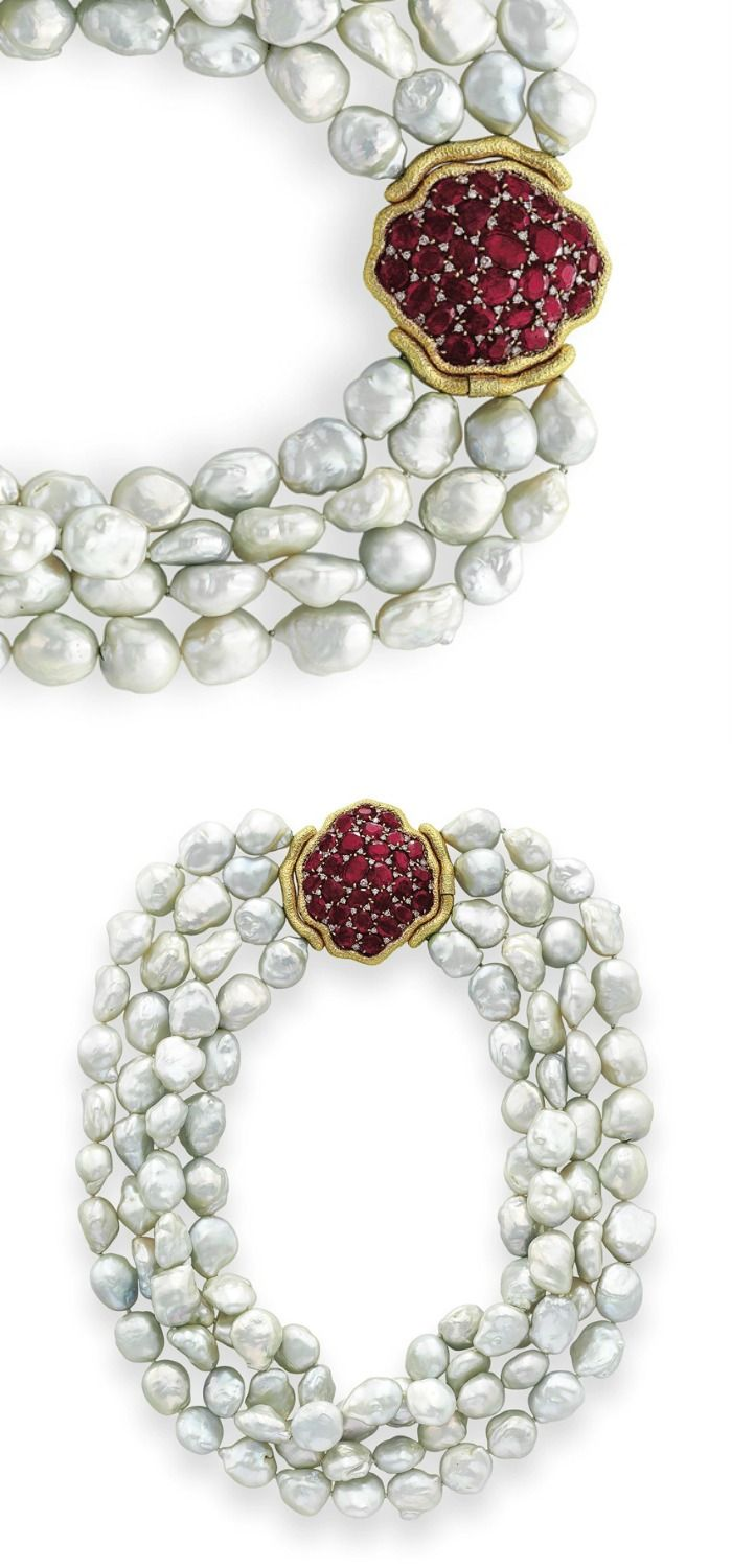 A CULTURED BAROQUE PEARL AND RUBY NECKLACE, BY MICHELE DELLA VALLE: Designed as a four-strand baroque cultured pearl necklace, with a hammered gold free form plaque clasp, set with oval-cut rubies, 20 1/2 ins. (shortest strand), mounted in 18k gold. Signed MdV for Michele della Valle. Via Christie's.