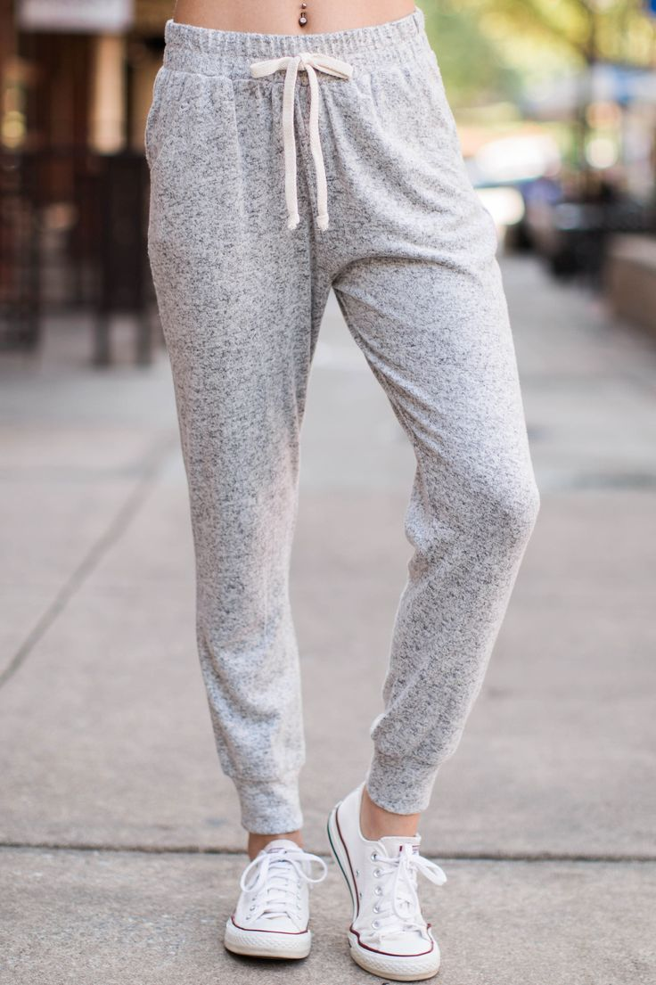 Always on the go and getting things done, you're not gonna let restrictive clothes in your way, so the Fringe Too Legit Heather Grey Jogger Pants are perfect for you! You'll be moving around with ease, with the comfort of pajamas, in these fashionable joggers! These soft and fuzzy joggers feature a relaxed fit, elastic drawstring waist, functional slant side pockets, tapered legs, and ankle cuffs. Model is wearing a small.  • 98% Rayon, 2% Spandex  • Hand Wash Cold • Unlined • Made in the…