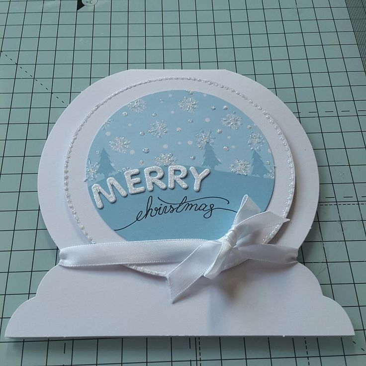 Handmade card using Craftwork Cards snow globe cards and snowy scenes by Mary Gillingham
