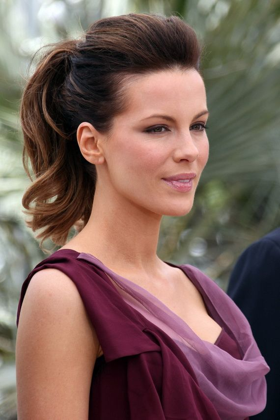 Kate Beckinsale looks radiant in a Christian Dior plum ensemble during a jury photocall at Cannes