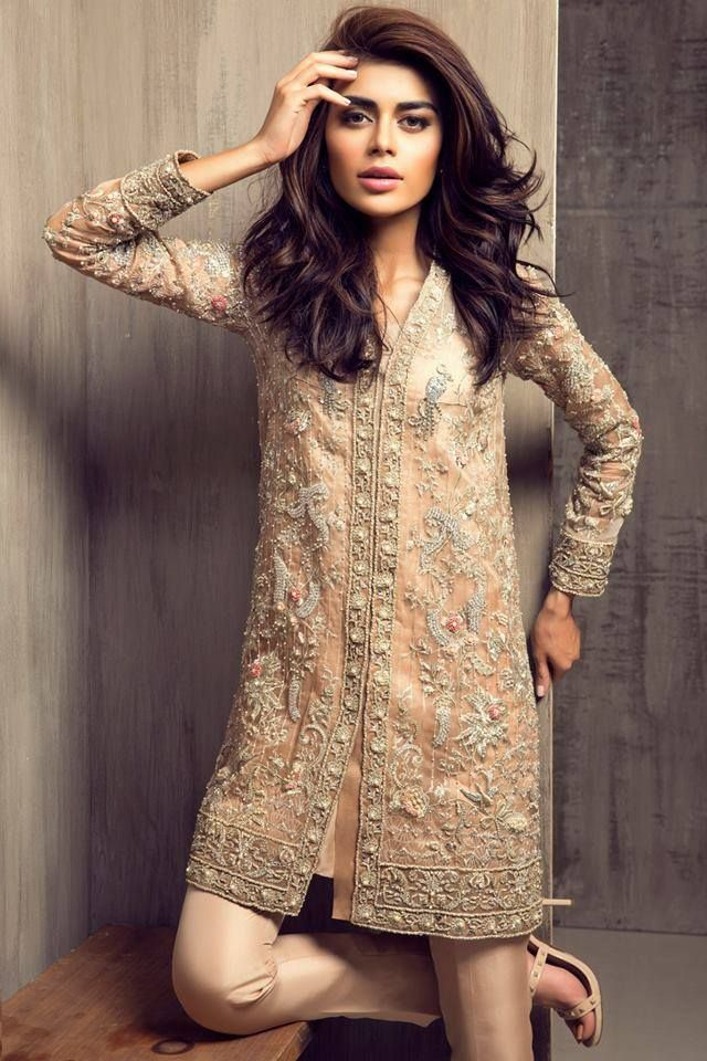 Short embellished kurta over cigarette trousers