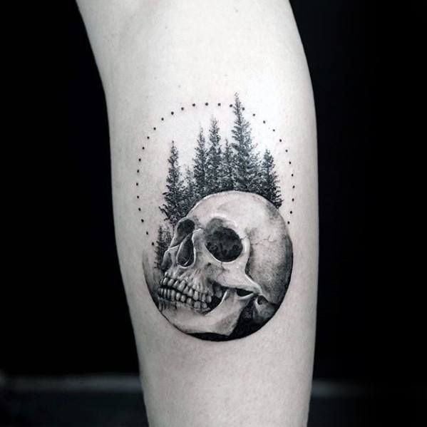 Skull With Trees And Circle Mens Small Detailed Tattoo On Leg Tattoos For Guys Small Skull Tattoo Detailed Tattoo