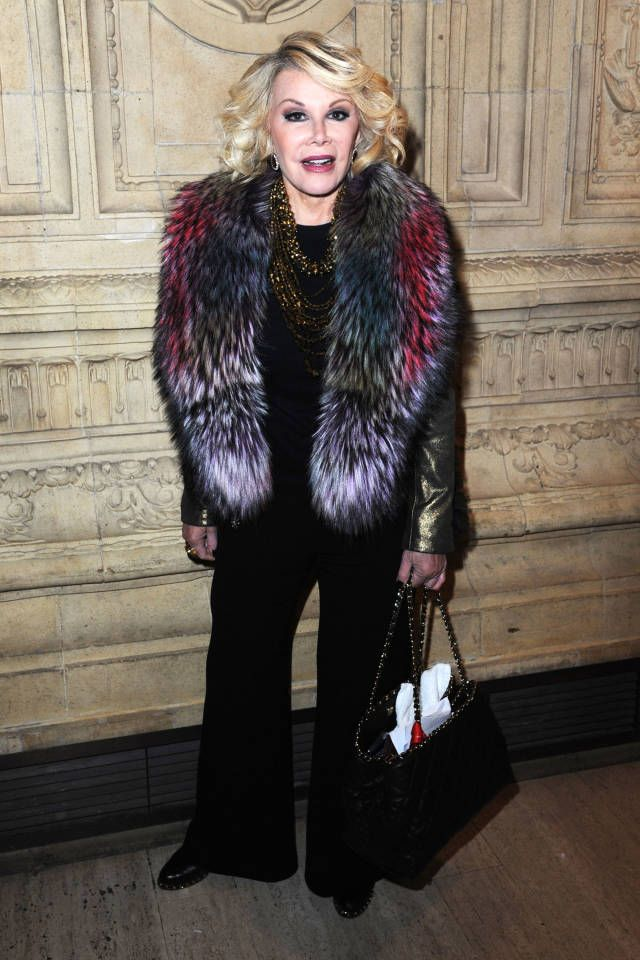RIP to the legendary comedian, Joan Rivers. Take a look back at the Queen of Laughter's most stylish moments.