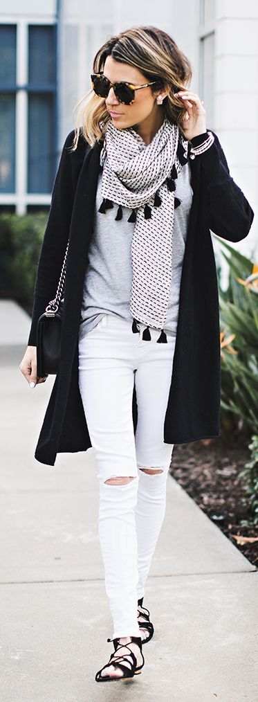 Wearing black and white makes experimenting with new trends easy. We're loving how subtle the tassels look on this casual chic look.