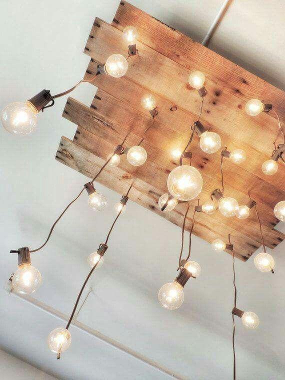 Light bulbs on a wood plank