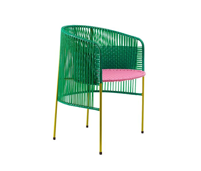 All plastic!  Sebastian Herkner revisits woven plastic with this traditional outdoor chair made in Colombia.  (Collection Caribe, Ames)