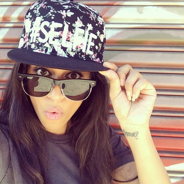 Hi this is lilly. She had rough past that she doesn't like to talk about.  And she lovves love hats. YouTube is IISuperWomanII