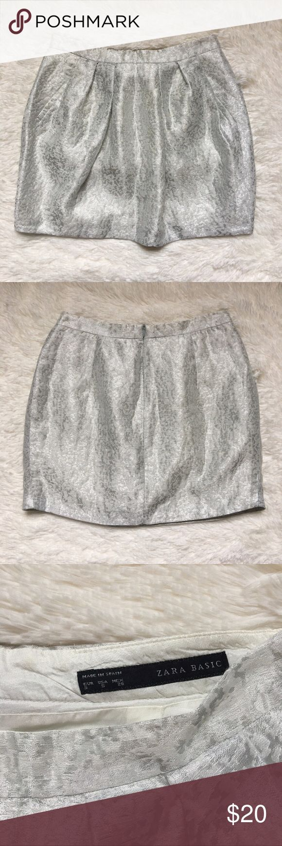Zara mini skirt Zara mini skirt in size Small. No tears or rips. Great condition. Has the look of pockets in front but it's only for show. Zara Skirts Mini