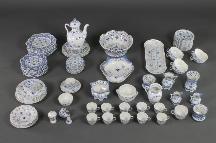 Lot 141, A Royal Copenhagen Onion pattern matched quantity of tableware comprising a coffee pot, 10 coffee cups, 6 tea cups, 1 other cup, 11 saucers, 3 jugs, 4 vases, a fruit bowl, oval dish, hors d'oeuvres dish, trefoil dish, 8 small plates, 6 medium plates, 11 small saucers, 6 medium saucers, a pair of condiments, a bowl, a bottle opener, 8 small dishes, 7 plates, a bowl and dish, sold for £1,500