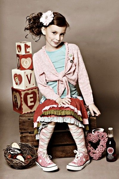 Oh. my. gosh.  She is so adorable.  Good idea for photo shoot.