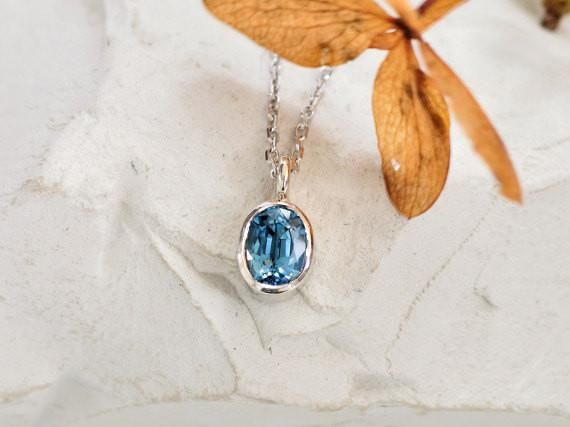 Montana Blue Sapphire Gold Layering Necklace #blue_sapphire #blue_sapphire_birthstone_jewelry #blue_sapphire_layering_necklace