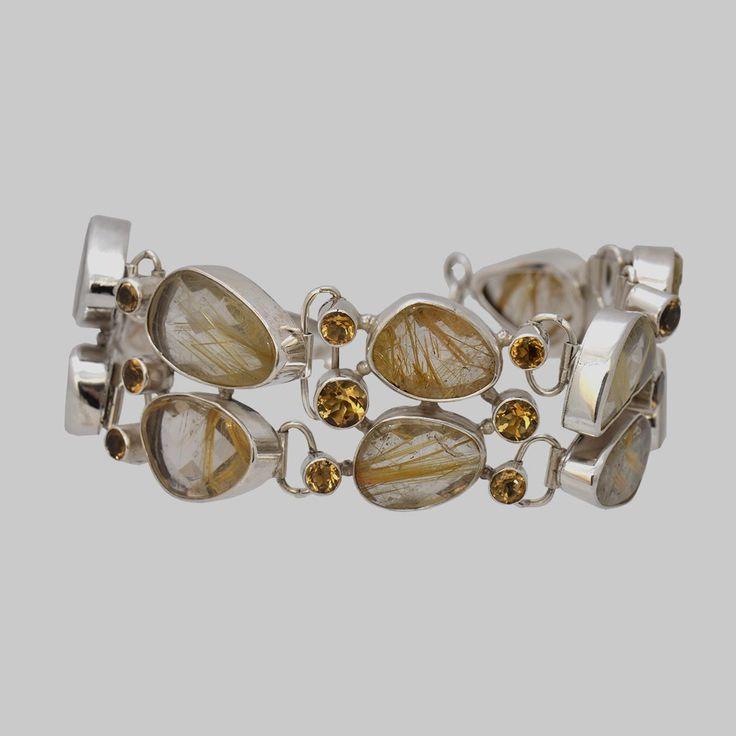 Brățară din argint realizată cu pietre fațetate de cuarț cu incluziuni de rutil, combinate cu citrin fațetat.