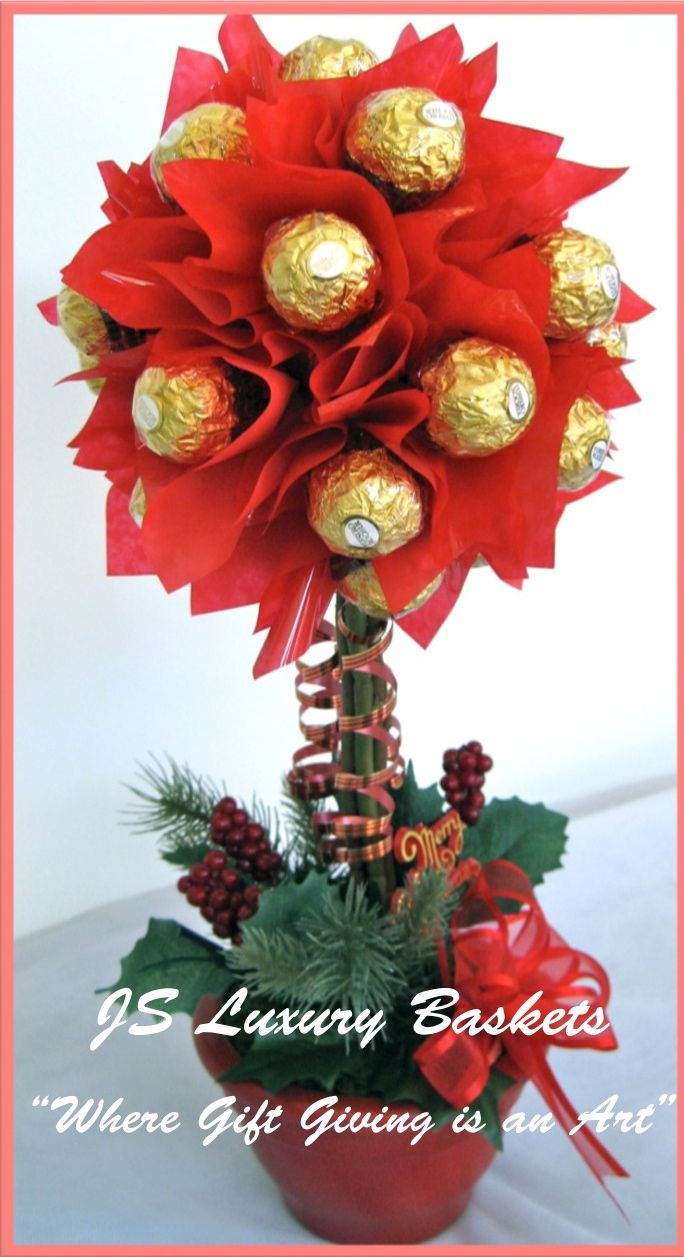"""CHRISTMAS TOPIARY TREE"" -  Candy Arrangement: Our Candy Topiary is made of Ferrero Roche chocolates, decorated with silk flowers!  A beautiful Christmas centrepiece! www.facebook.com/jsluxurybaskets www.jsluxurybaskets.com.au"