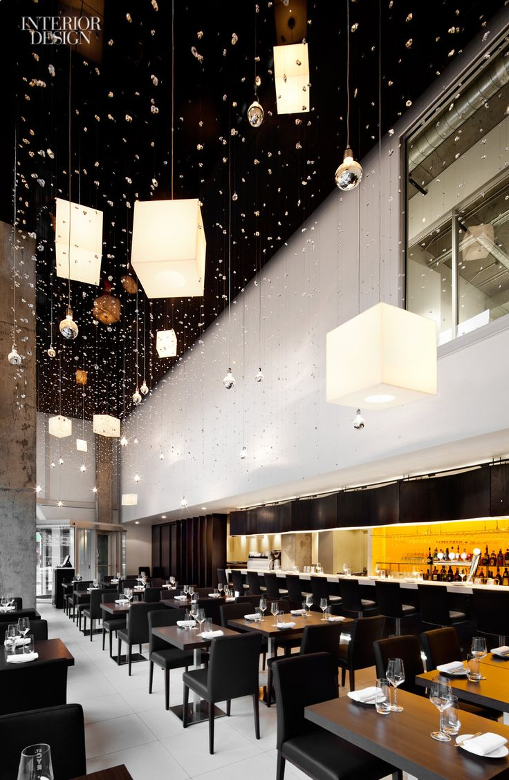 Crystals dangle from the ceiling at the Le St-Cyr Restaurant in Montreal by 2013Interior Design Giant Aedifica.  See more projects by 2013's Giants here